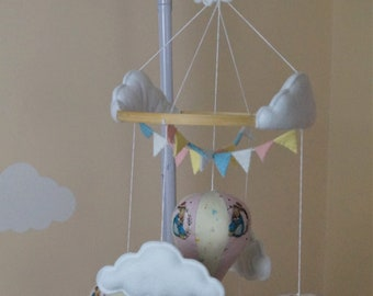 Musical hot air balloon unisex baby mobile blue, pink pastel yellow with Peter Rabbit