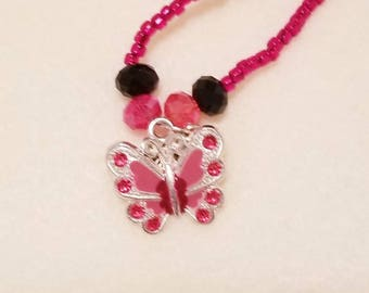 Red and black beaded butterfly necklace.