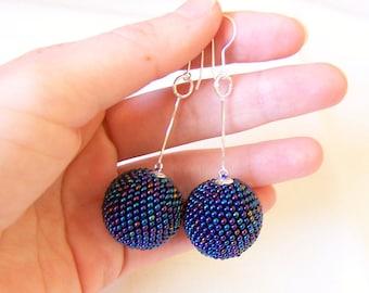 Long globe earrings in Iridescent blue - dangle ball earrings - statement earrings - sterling silver hooks - beaded ball earrings