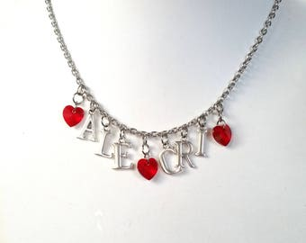 Steel necklace with initials and heart of red Swarovski, with names or initials