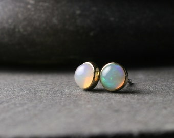 Bezel set 5mm opal stud earrings set in solid 18k yellow gold