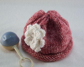 Rose colored rolled brim baby hat
