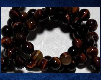 "Tigereye, Red - 15"" strand of 6mm smooth round ball. Approx 62 gemstone beads. #TIGR-065"