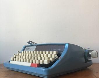 1970s Vintage Brother Opus 899 Blue Typewriter.