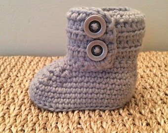 Baby booties with buttons.