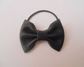 With black leather bow hair tie