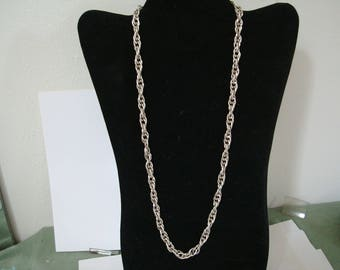 SIMPLE UP TO 24 inch chain necklace in new condittion.  See description and photo areas for info