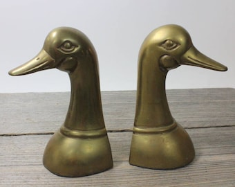 A wonderful pair of vintage brass duck book ends, vintage patina. Marked Andrea by Sadek and made in Korea. Decor, bookends, office, brass