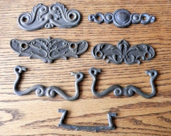 A group of vintage hardware pieces 6 backplates and 3 bails fpr crafts