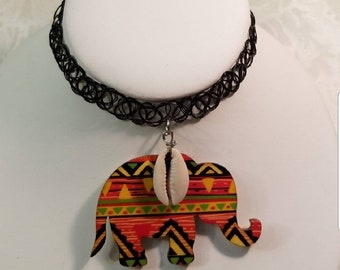 Black simulated Tattoo Pinted Stretchable choker with dangling Elephant shape with top Cowrie charm Choker.   Fits Small to Large Necklines.