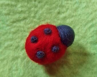 Brooch of felt (soft wool): Ladybug in red