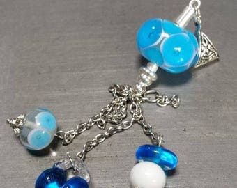 In shades of blue glass pendant. Lampwork Glass Beads