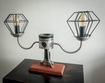 Twin lumiere piston conrod lamp