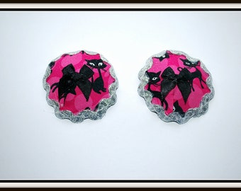 Burlesque Style Pasties in Retro Cats and Topped with a Black Bow