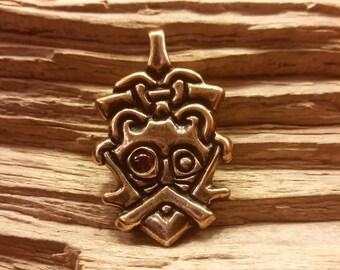 01.221.BZ/GA  Odin face pendant with Garnet eye based on a Viking era piece