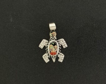sterling silver Inlay Multi-colored Pueblo scene on turtle pendant