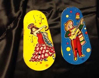 Vintage pair metal party noisemaker, Tin flamenco dancer, tin señor guitar player, 1950s, vintage toy party noisemaker