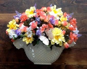 Handmade arrangement in vintage wall hanging basket