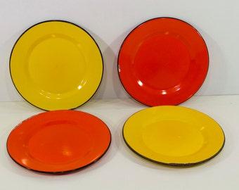 Four Vintage Orange and Yellow Enamel Plates