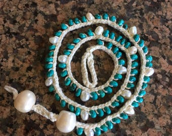 Crochet beige cotton and faceted turquoise and freshwater pearls, finished with 2 jumbo freshwater potato pearls for an adjustable closure