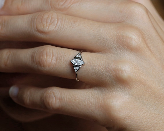 marquise diamond engagement ring trillion diamond ring. Black Bedroom Furniture Sets. Home Design Ideas