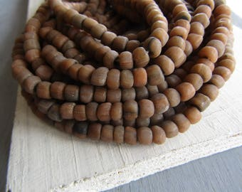 Brown grey glass seed beads , small rustic ethnic spacer , irregular tube barrel indonesia new  Indo-pacific 4 to 6mm (22 inch strd) 7ab58-1