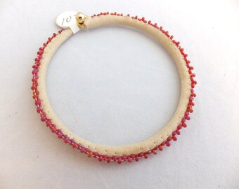 Leather edge beaded bangle in frosted red