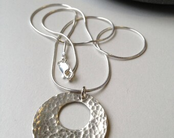Round hammered silver cutout pendant