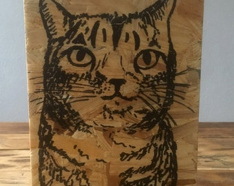 Drawing ' cat ' on wood