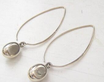 "2.5"" SILPADA Sterling Silver Long Drop Earrings.  5/8"" Slightly Flattened Oval Drop Charms Hang from Nearly 2"" Long Leaf Shape Ear Wires."