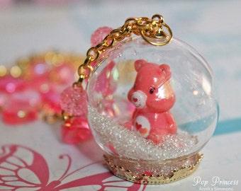 Kawaii Special Edition: Pink Love a Lot Care Bear in Glass Snow, Hearts, Stars Globe Ring Terrarium