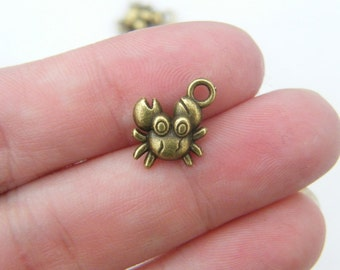 10 Crab charms antique bronze tone BC38