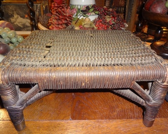 Wicker foot stool with brass feet...great for display...creating a vignette
