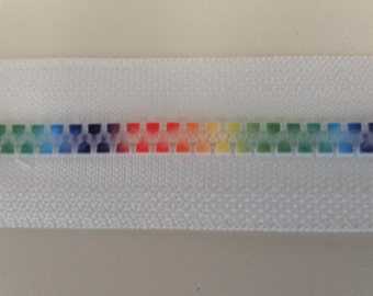 Rainbow Plastic Zipper Continuous White Tape #5 Rainbow zipper tape on white Rainbow colored zipper teeth on white tape zipper chain tape