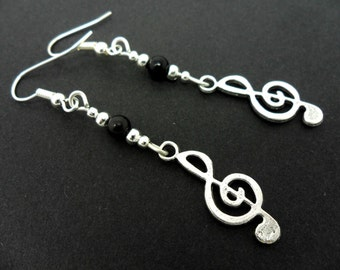 A pair of cute tibetan silver treble clef musical note  themed  dangly earrings.
