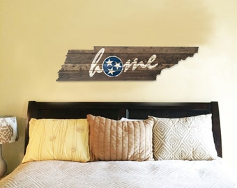 Wooden state of Tennessee cut out with HOME painted and distressed on it!