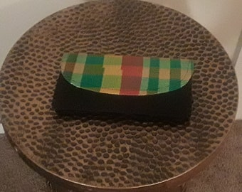 Green and black woven clutch bag