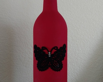 Red Wine Bottle With Black Butterfly Accent