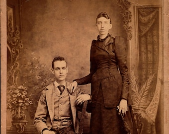 antique cabinet photo extra tall lady with smaller man from knoxville tennessee
