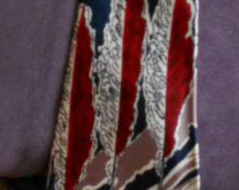 """1940's, 48"""" long, dark blue satin tie, with a graduated design of abstract gray palm trees and surf in red"""