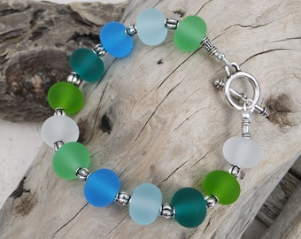 Lampwork beaded bracelet.  Sea glass colors.  Coastal.  Ocean vibe. SALE was 45.00
