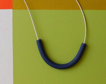 not quite a semicircle makes a necklace