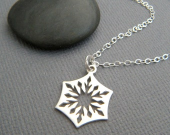 small silver snowflake necklace. sterling silver cut out snow flake charm delicate petite simple everyday jewelry dainty winter pendant 5/8""