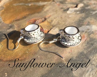 Porcelin dolls house tea cup and saucer earrings, on silver plated hooks.