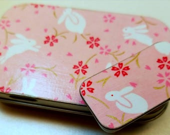 Large hinge tin and Small slide tin Duo. . . White Bunnies with Pink flowers.   . . .