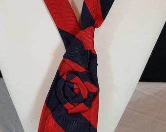 Women's necktie made using a repurposed necktie. Necktie jewelry made from an upcycled necktie