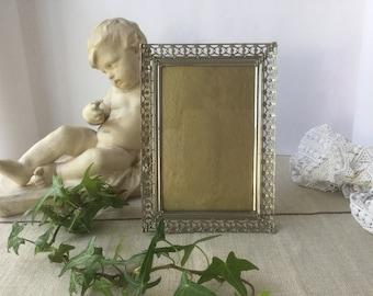 French vintage frame in metal and varnished wood