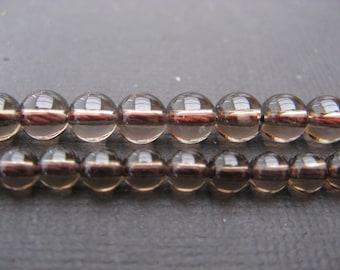 Smoky quartz: 20 round beads 4 mm.