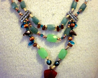 Mint Green Multi Strand Bib Statement Necklace with Faceted Aventurine Vintage Rhinestone Connectors and Carved Carnelian Shell Pendant