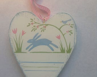 Wooden heart, rabbit and bird.